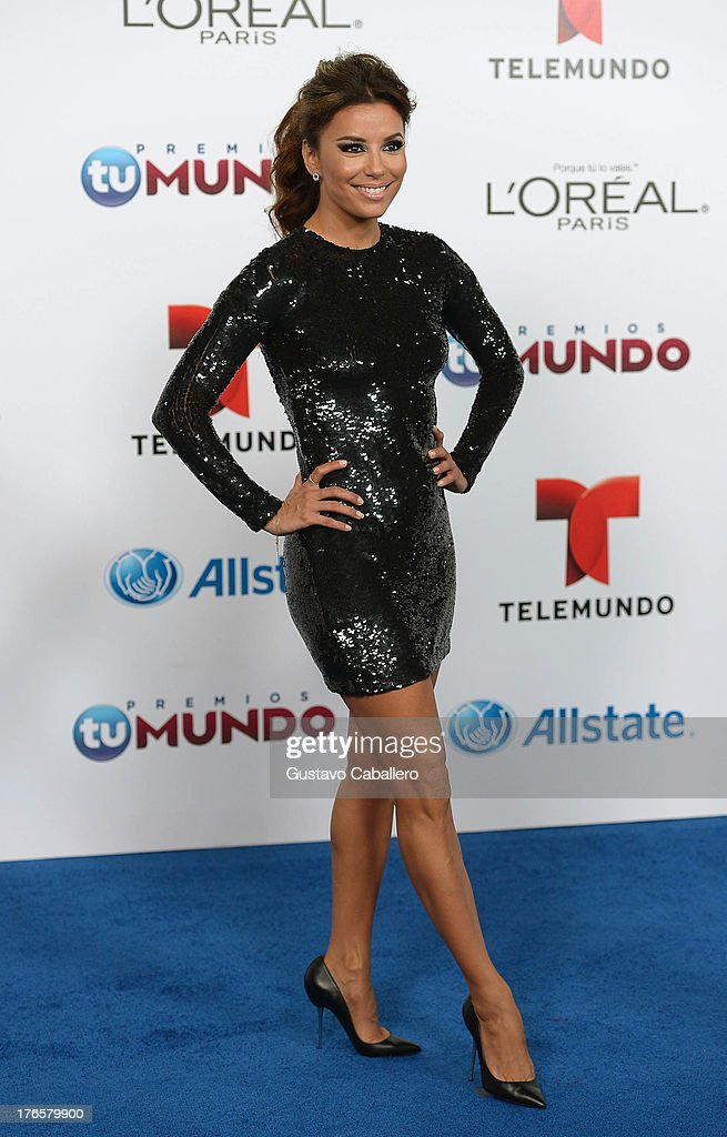 Actress Eva Longoria arrives for Telemundo's Premios Tu Mundo Awards at American Airlines Arena on August 15, 2013 in Miami, Florida.