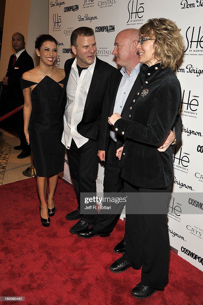 Actress Eva Longoria arrives with Tilman Fertitta, President and CEO of Landry's Inc., retired astronaut Mark Kelly and his wife Former Arizona Rep. Gabrielle Giffords arrive at the grand opening of SHe by Morton's at Crystals at CityCenter on February 2, 2013 in Las Vegas, Nevada.
