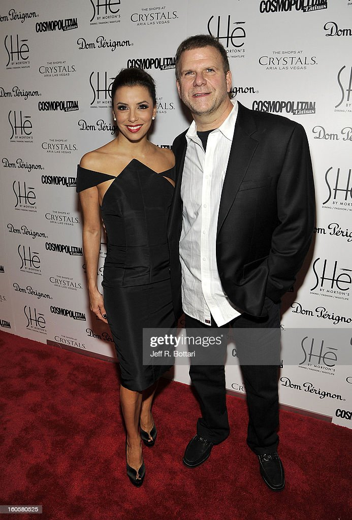 Actress <a gi-track='captionPersonalityLinkClicked' href=/galleries/search?phrase=Eva+Longoria&family=editorial&specificpeople=202082 ng-click='$event.stopPropagation()'>Eva Longoria</a> arrives with Tilman Fertitta (R), President and CEO of Landry's Inc., at the grand opening of SHe by Morton's at Crystals at CityCenter on February 2, 2013 in Las Vegas, Nevada.