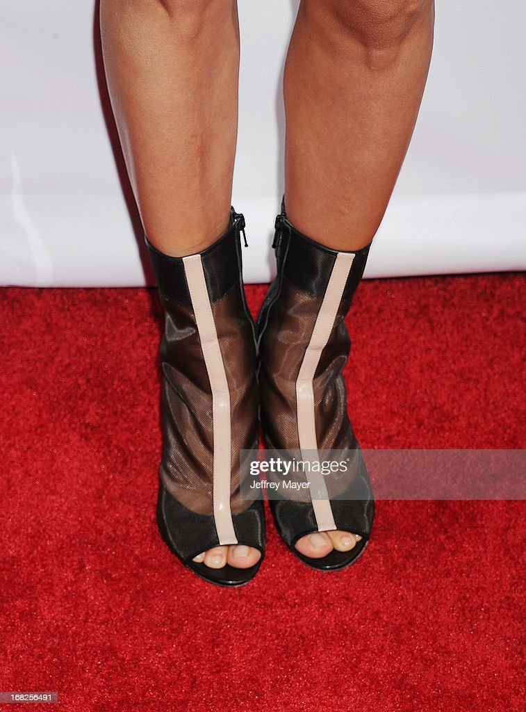 Actress <a gi-track='captionPersonalityLinkClicked' href=/galleries/search?phrase=Eva+Longoria&family=editorial&specificpeople=202082 ng-click='$event.stopPropagation()'>Eva Longoria</a> (shoe detail) at the <a gi-track='captionPersonalityLinkClicked' href=/galleries/search?phrase=Eva+Longoria&family=editorial&specificpeople=202082 ng-click='$event.stopPropagation()'>Eva Longoria</a> announces contest winner for 'Lay's 'Do Us A Flavor' Contest at Beso on May 6, 2013 in Hollywood, California.