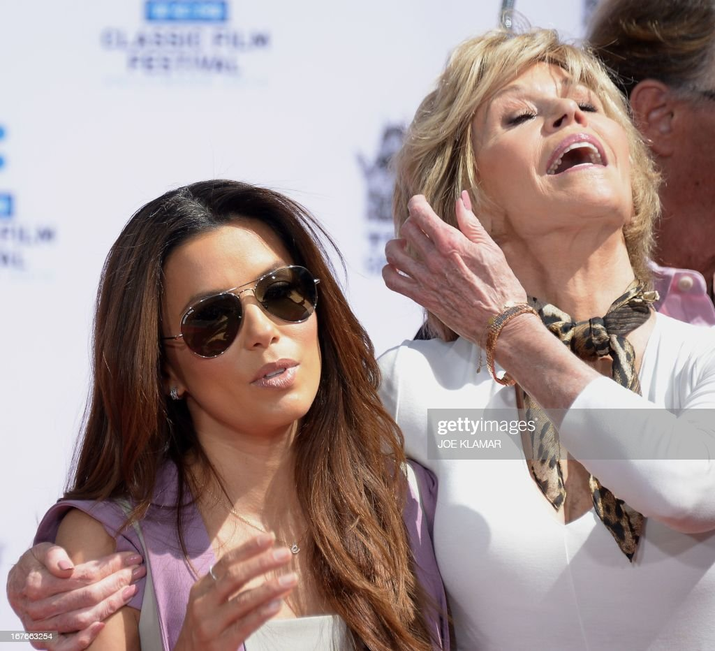 Actress Eva Longoria (L) attends actress Jane Fonda's (R) Handprint/Footprint Ceremony during the 2013 TCM Classic Film Festival at TCL Chinese Theatre on April 27, 2013 in Los Angeles. Fonda is an American actress, writer, political activist, former fashion model, and fitness guru. She rose to fame in the 1960s with films such as Barbarella and Cat Ballou. She has won two Academy Awards, an Emmy Award, three Golden Globes and received several other movie awards and nominations during more than 50 years as an actress. After 15 years of retirement, she returned to film in 2005 with Monster-in-Law, followed by Georgia Rule two years later. She also produced and starred in over 20 exercise videos released between 1982 and 1995, and once again in 2010.