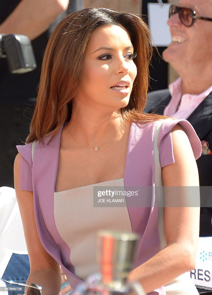 Actress Eva Longoria attends Jane Fonda's Handprint/Footprint Ceremony during the 2013 TCM Classic Film Festival at TCL Chinese Theatre on April 27, 2013 in Los Angeles. Fonda is an American actress, writer, political activist, former fashion model, and fitness guru. She rose to fame in the 1960s with films such as Barbarella and Cat Ballou. She has won two Academy Awards, an Emmy Award, three Golden Globes and received several other movie awards and nominations during more than 50 years as an actress. After 15 years of retirement, she returned to film in 2005 with Monster-in-Law, followed by Georgia Rule two years later. She also produced and starred in over 20 exercise videos released between 1982 and 1995, and once again in 2010.
