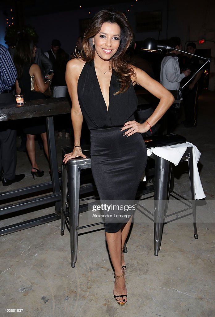Actress Eva Longoria attends Moments In Motion, An Exclusive Unveiling Of Never Before Seen Photos At De Nolet, Miami For Art Basel on December 5, 2013 in Miami, Florida.