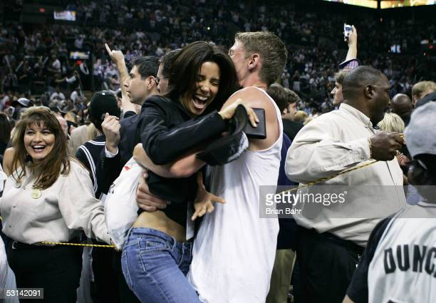 Actress Eva Longoria celebrates with an unknown fan as the San Antonio Spurs defeat the Detroit Pistons in Game seven of the 2005 NBA Finals at SBC...