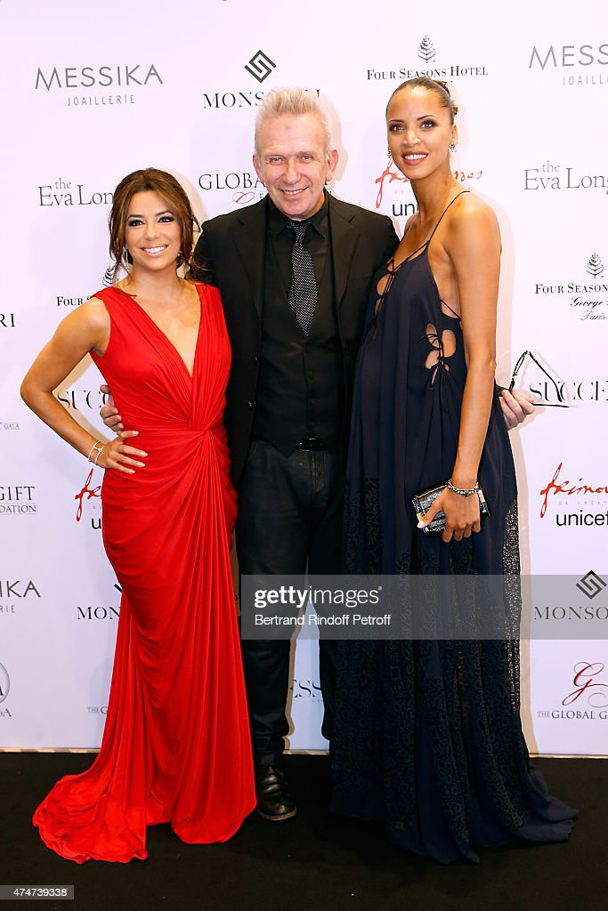 Actress <a gi-track='captionPersonalityLinkClicked' href=/galleries/search?phrase=Eva+Longoria&family=editorial&specificpeople=202082 ng-click='$event.stopPropagation()'>Eva Longoria</a>, Fashion designer Jean-Paul Gaultier and Pregnant actress <a gi-track='captionPersonalityLinkClicked' href=/galleries/search?phrase=Noemie+Lenoir&family=editorial&specificpeople=240424 ng-click='$event.stopPropagation()'>Noemie Lenoir</a> attend the Global Gift Gala : Photocall. Held at Four Seasons Hotel George V on May 25, 2015 in Paris, France.