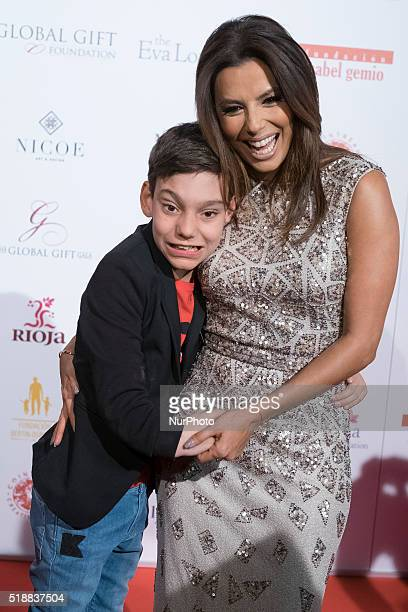 Actress Eva Longoria greets Adrian Martin Vega as they attend the Global Gift Gala at Cibeles Palace on April 2 2016 in Madrid Spain