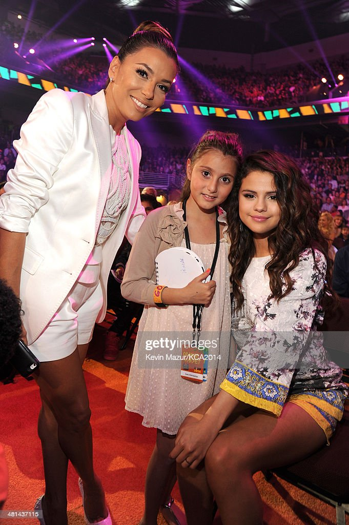 Actress Eva Longoria, guest and actress/singer Selena Gomez attend Nickelodeon's 27th Annual Kids' Choice Awards held at USC Galen Center on March 29, 2014 in Los Angeles, California.