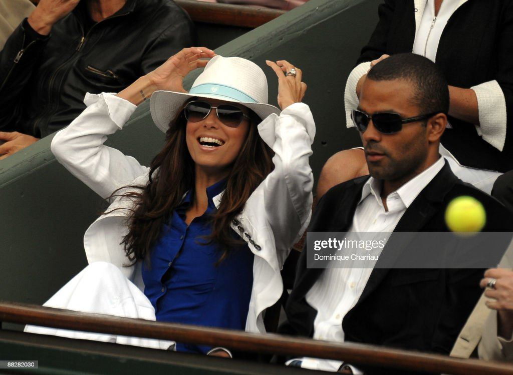 Actress Eva Longoria Parker and NBA Basketball player Tony Parker watches the action during the French Open Men's Singles Final match between Robin Soderling of Sweden and Roger Federer of Switzerland on June 7, 2009 in Paris, France.