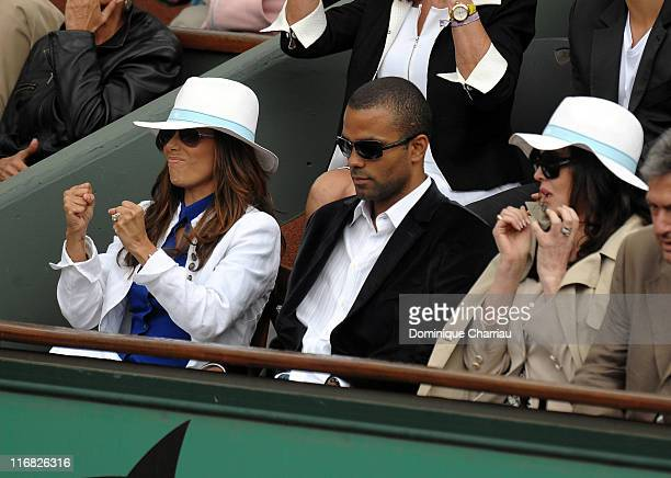 Actress Eva Longoria Parker her husband NBA Basketball player Tony Parker and French Actress Isabelle Adjani watch the action during the French Open...