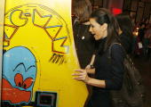 Actress Eva Longoria plays PacMan at the afterparty for the premiere of Warner Bros Picture's 'Music and Lyrics' at the Annix on February 7 2007 in...