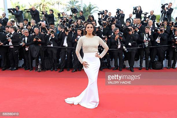 US actress Eva Longoria poses as she arrives on May 11 2016 for the opening ceremony of the 69th Cannes Film Festival in Cannes southern France / AFP...