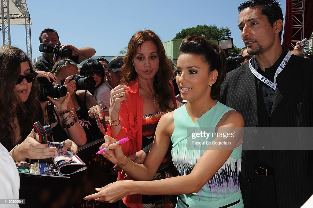 Actress <a gi-track='captionPersonalityLinkClicked' href=/galleries/search?phrase=Eva+Longoria&family=editorial&specificpeople=202082 ng-click='$event.stopPropagation()'>Eva Longoria</a> signs autographs as she arrives to attend a photocall for 'Desperate Housewives' during the 52nd Monte Carlo TV Festival on June 13, 2012 in Monte-Carlo, Monaco.