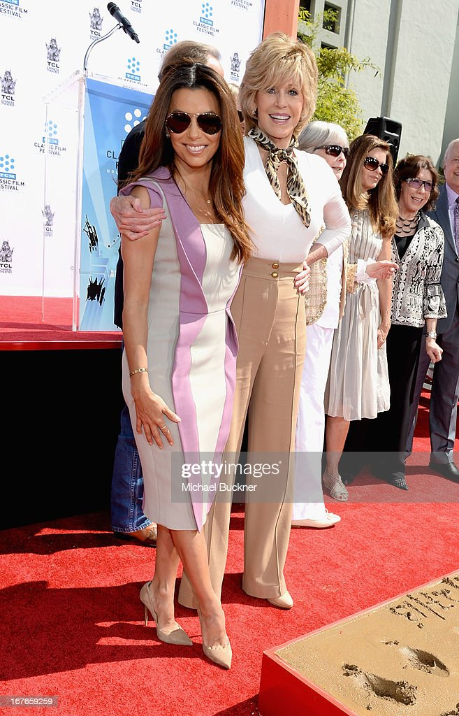 Actress <a gi-track='captionPersonalityLinkClicked' href=/galleries/search?phrase=Eva+Longoria&family=editorial&specificpeople=202082 ng-click='$event.stopPropagation()'>Eva Longoria</a> (L) with actress <a gi-track='captionPersonalityLinkClicked' href=/galleries/search?phrase=Jane+Fonda&family=editorial&specificpeople=202174 ng-click='$event.stopPropagation()'>Jane Fonda</a> during her Handprint/Footprint Ceremony during the 2013 TCM Classic Film Festival at TCL Chinese Theatre on April 27, 2013 in Los Angeles, California. 23632_009_MB_0785.JPG