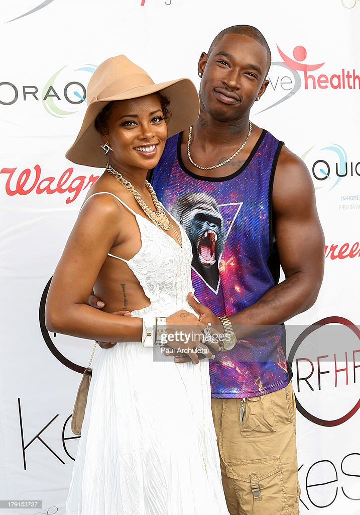 Actress <a gi-track='captionPersonalityLinkClicked' href=/galleries/search?phrase=Eva+Marcille&family=editorial&specificpeople=208986 ng-click='$event.stopPropagation()'>Eva Marcille</a> (L) and her Husband Recording Artist Kevin McCall (R) attend the Reed For Hope Foundation's 11th annual 'Sunshine Beyond Summer' celebration on August 31, 2013 in Westlake Village, California.