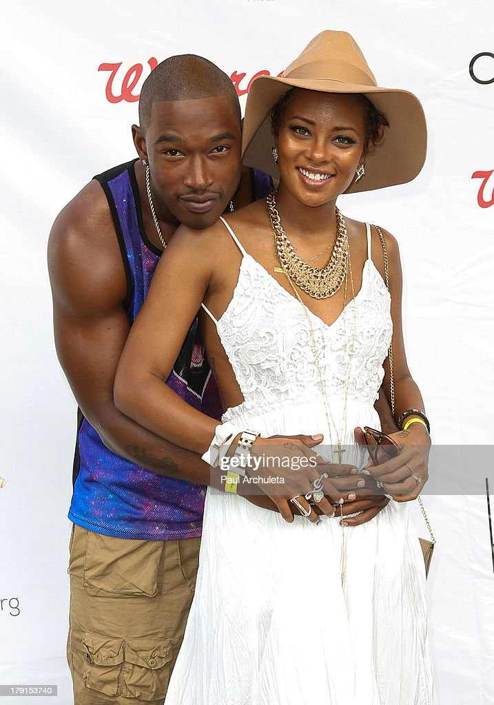 Actress <a gi-track='captionPersonalityLinkClicked' href=/galleries/search?phrase=Eva+Marcille&family=editorial&specificpeople=208986 ng-click='$event.stopPropagation()'>Eva Marcille</a> (R) and her Husband Recording Artist Kevin McCall (L) attend the Reed For Hope Foundation's 11th annual 'Sunshine Beyond Summer' celebration on August 31, 2013 in Westlake Village, California.