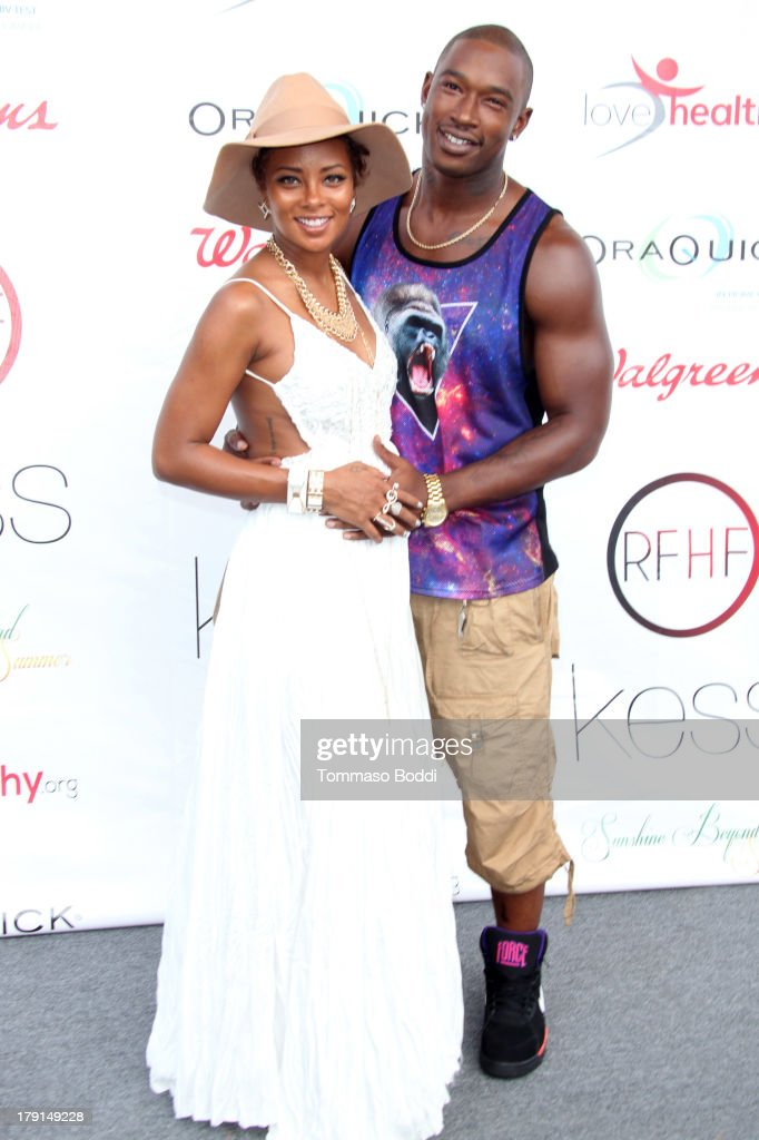 Actress <a gi-track='captionPersonalityLinkClicked' href=/galleries/search?phrase=Eva+Marcille&family=editorial&specificpeople=208986 ng-click='$event.stopPropagation()'>Eva Marcille</a> (L) and singer Kevin McCall attend the Reed For Hope Foundation's 11th annual 'Sunshine Beyond Summer' celebration on August 31, 2013 in Westlake Village, California.
