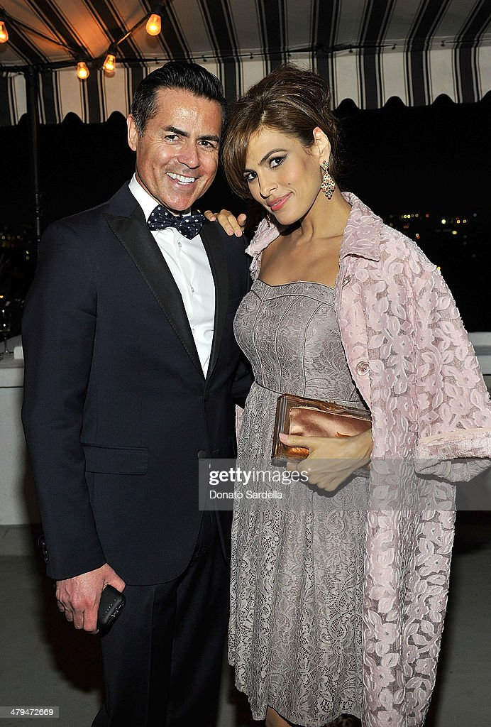 Actress Eva Mendes (R) and Greg Scott, Chief Executive Officer of New York & Company Inc. attends Eva Mendes Exclusively at New York & Company Spring launch dinner at Chateau Marmont on March 18, 2014 in Los Angeles, California.