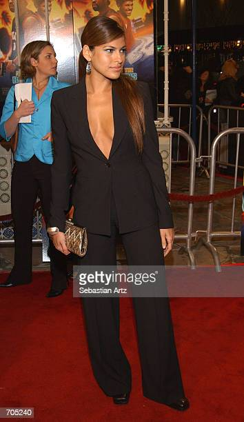 Actress Eva Mendes arrives at the premiere of the movie 'All About The Benjamins' March 6 2002 in Los Angeles CA