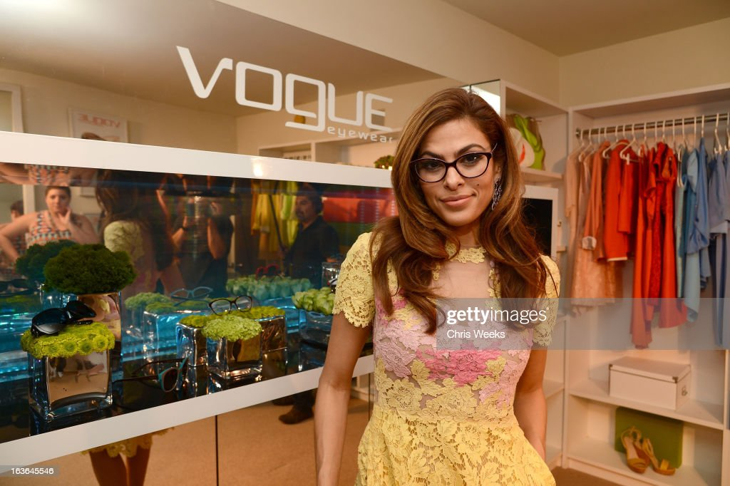 Actress <a gi-track='captionPersonalityLinkClicked' href=/galleries/search?phrase=Eva+Mendes&family=editorial&specificpeople=194937 ng-click='$event.stopPropagation()'>Eva Mendes</a> attends Vogue Eyewear and <a gi-track='captionPersonalityLinkClicked' href=/galleries/search?phrase=Eva+Mendes&family=editorial&specificpeople=194937 ng-click='$event.stopPropagation()'>Eva Mendes</a> celebrate the launch of the Spring/Summer Communications Campaign at Simon House on March 13, 2013 in Beverly Hills, California.