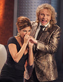 Actress Eva Mendes pretends to bit the hand of host Thomas Gottschalk on the 'Wetten Dass' television entertainment show at the Messehalle on...