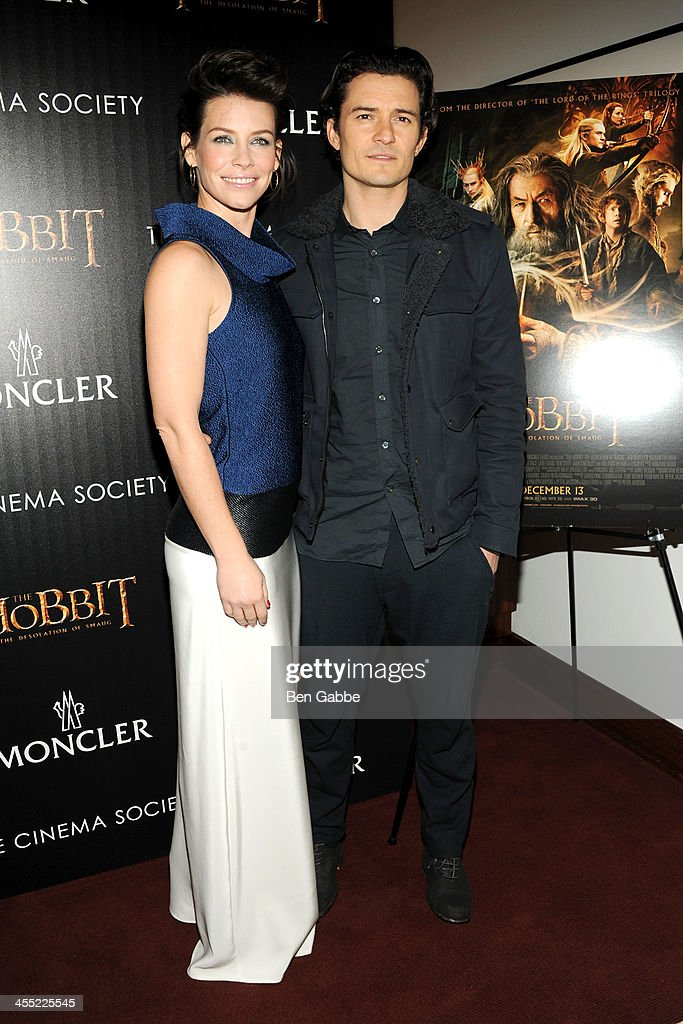 Actress Evangeline Lilly (L) and actor Orlando Bloom attend The Cinema Society & Moncler host a screening of New Line Cinema & MGM Pictures' 'The Hobbit: The Desolation of Smaug' at Time Warner Screening Room on December 11, 2013 in New York City.