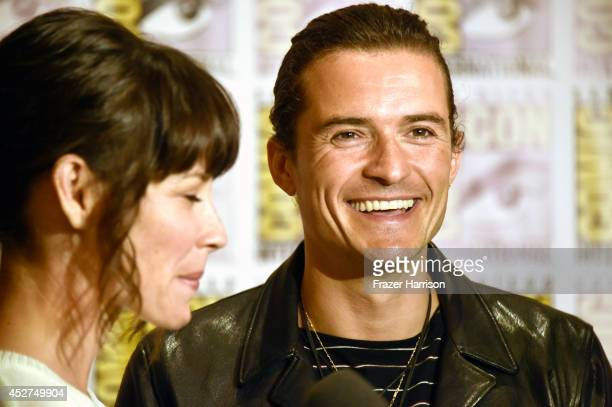 Actress Evangeline Lilly and actor Orlando Bloom attend 'The Hobbit The Battle Of The Five Armies' Press Line during ComicCon International 2014 at...