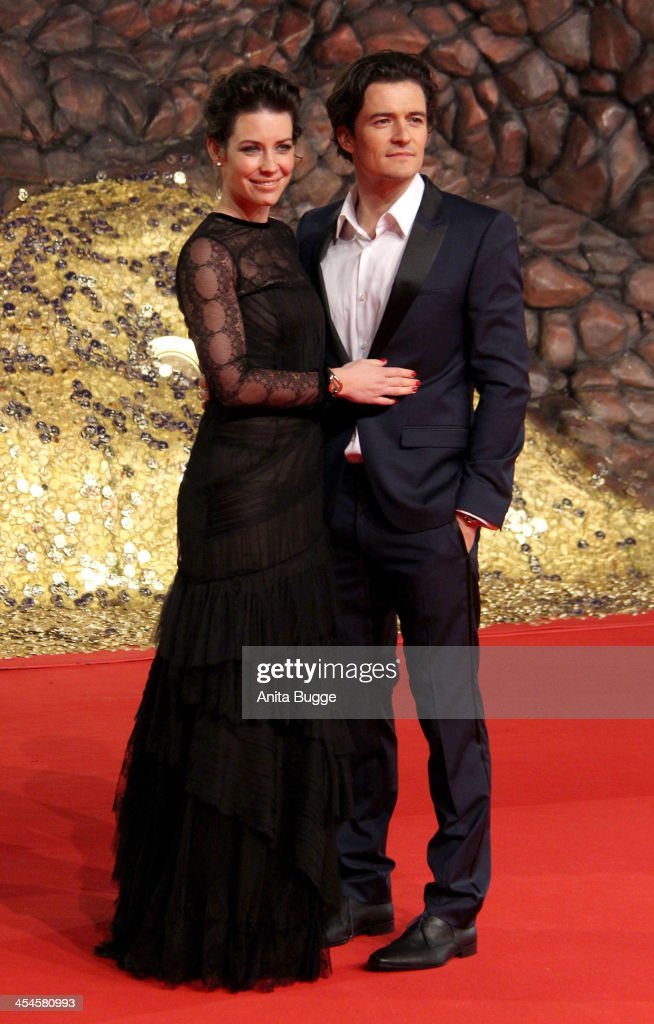 Actress Evangeline Lilly and actor Orlando Bloom attend the 'The Hobbit: The Desolation of Smaug' European Premiere at Cinestar on December 9, 2013 in Berlin, Germany.