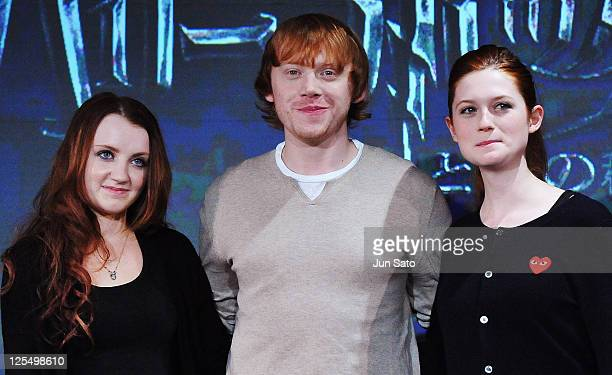 Actress Evanna Lynch actor Rupert Grint and actress Bonnie Wright pose during a press conference for 'Harry Potter and the Deathly Hallows Part 1' at...