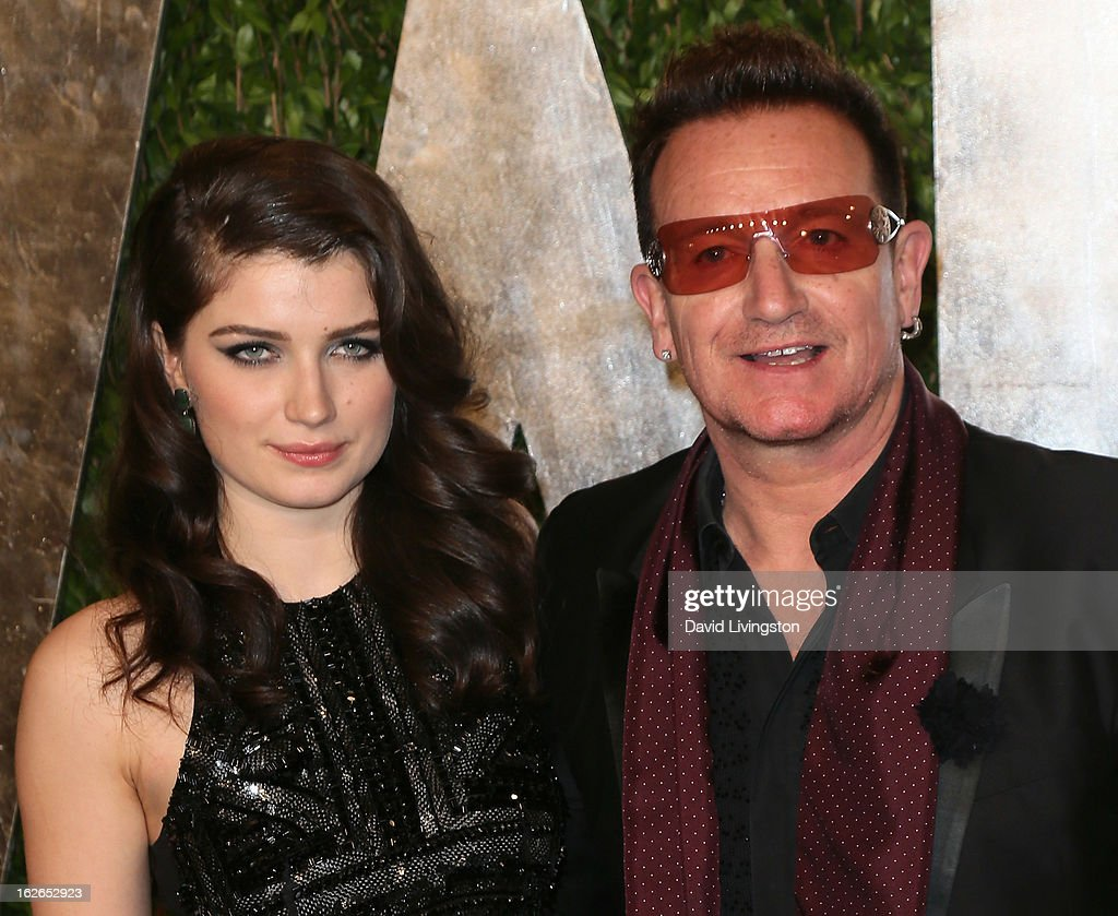 Actress Eve Hewson (L) and father recording artist Bono attend the 2013 Vanity Fair Oscar Party at the Sunset Tower Hotel on February 24, 2013 in West Hollywood, California.