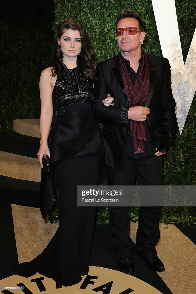 Actress Eve Hewson and singer Bono arrive at the 2013 Vanity Fair Oscar Party hosted by Graydon Carter at Sunset Tower on February 24, 2013 in West Hollywood, California.