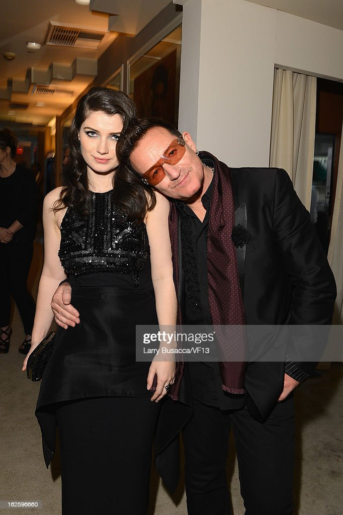 Actress <a gi-track='captionPersonalityLinkClicked' href=/galleries/search?phrase=Eve+Hewson&family=editorial&specificpeople=5294973 ng-click='$event.stopPropagation()'>Eve Hewson</a> and singer <a gi-track='captionPersonalityLinkClicked' href=/galleries/search?phrase=Bono+-+Singer&family=editorial&specificpeople=167279 ng-click='$event.stopPropagation()'>Bono</a> attend the 2013 Vanity Fair Oscar Party hosted by Graydon Carter at Sunset Tower on February 24, 2013 in West Hollywood, California.