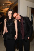 Actress Eve Hewson and singer Bono attend the 2013 Vanity Fair Oscar Party hosted by Graydon Carter at Sunset Tower on February 24 2013 in West...