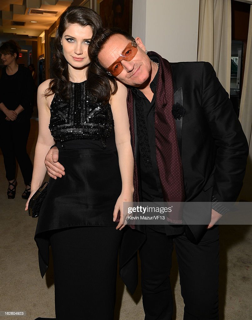Actress Eve Hewson (L) and singer Bono attend the 2013 Vanity Fair Oscar Party hosted by Graydon Carter at Sunset Tower on February 24, 2013 in West Hollywood, California.