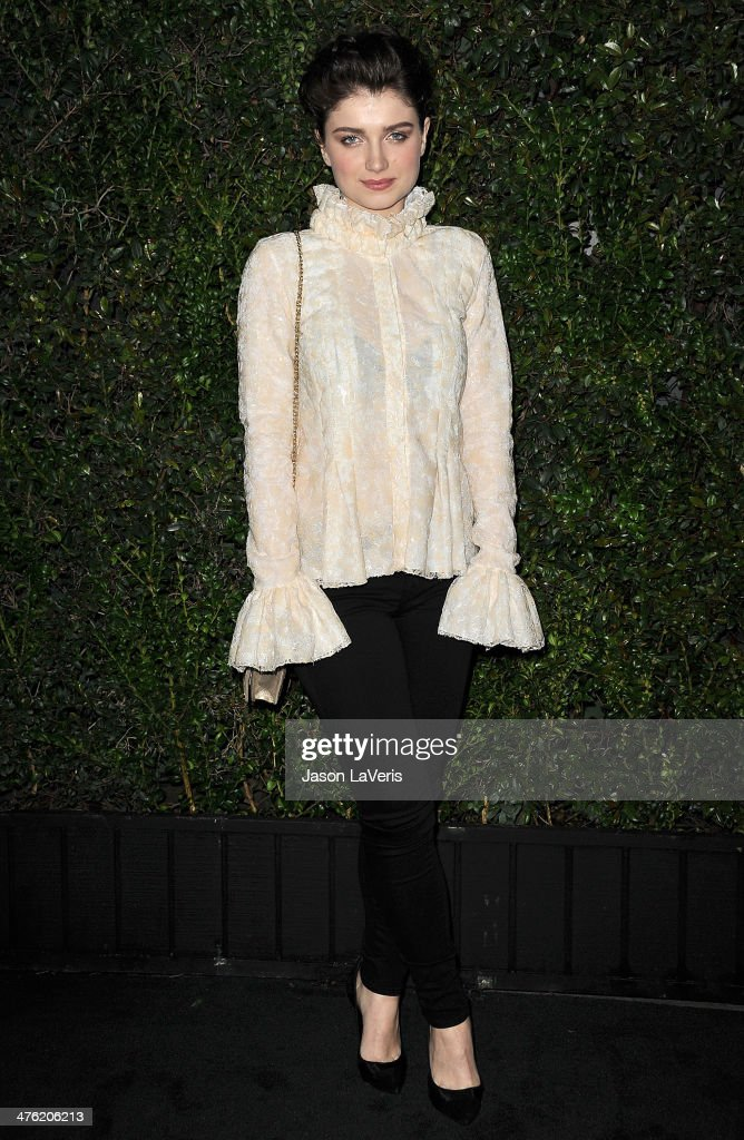 Actress Eve Hewson attends the Chanel and Charles Finch pre-Oscar dinner at Madeo Restaurant on March 1, 2014 in Los Angeles, California.