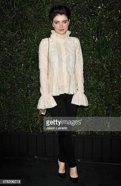 Actress Eve Hewson attends the Chanel and Charles Finch preOscar dinner at Madeo Restaurant on March 1 2014 in Los Angeles California