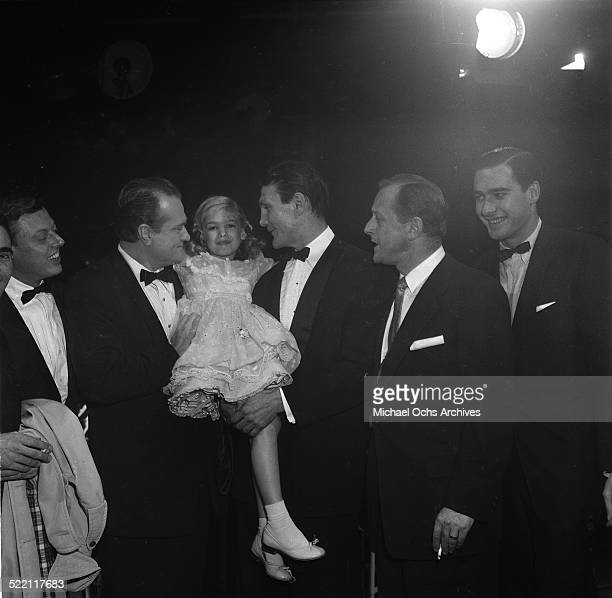 Actress Evelyn Rudie poses with Red Skelton and Jack Palance during the Emmy Nominations in Los AngelesCA