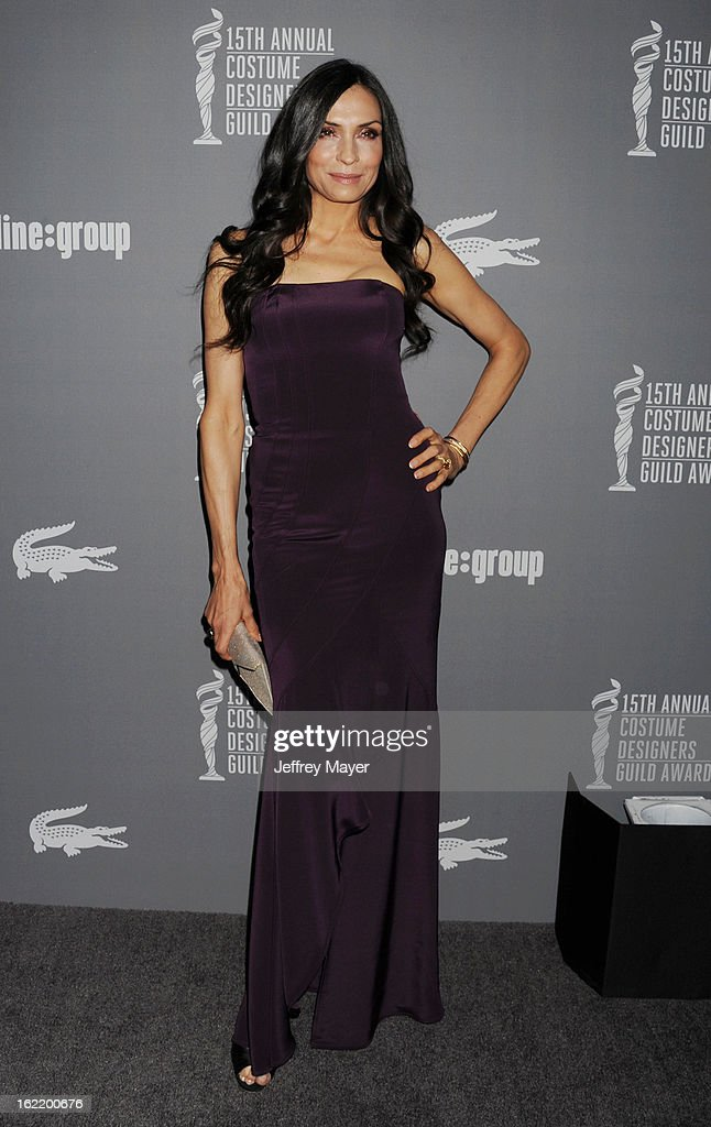 Actress Famke Janssen arrives at the 15th Annual Costume Designers Guild Awards at The Beverly Hilton Hotel on February 19, 2013 in Beverly Hills, California.