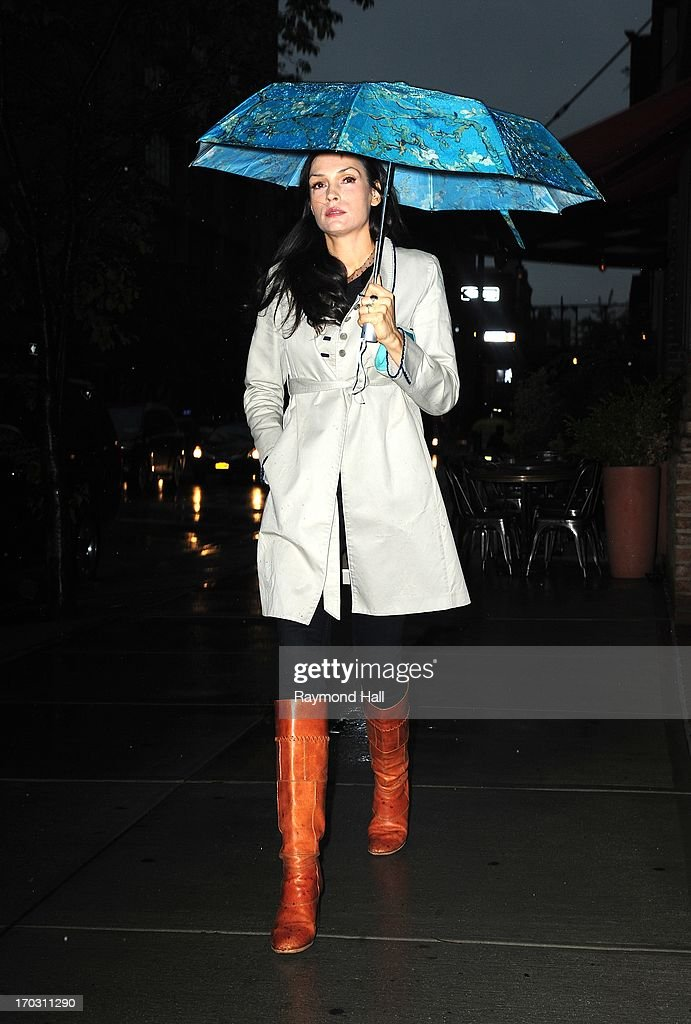 Actress <a gi-track='captionPersonalityLinkClicked' href=/galleries/search?phrase=Famke+Janssen&family=editorial&specificpeople=202594 ng-click='$event.stopPropagation()'>Famke Janssen</a> is seen in Soho on June 10, 2013 in New York City.