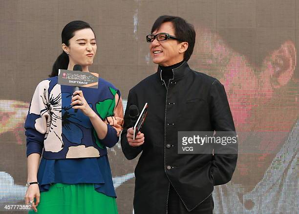 Actress Fan Bingbing and actor Jackie Chan attend 'Skiptrace' press conference on October 23 2014 in Beijing China