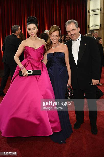 Actress Fan Bingbing Chopard's Caroline Scheufele and Pandemonium Entertainment's Bill Mechanie arrive at the Oscars at Hollywood Highland Center on...