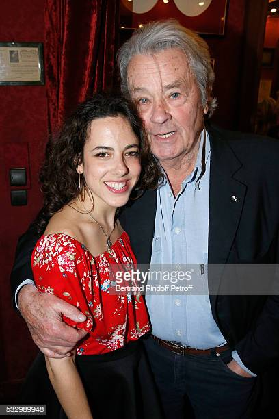 Actress Fanny Guillot and Alain Delon attend the 100th representation of the Theater piece 'Un nouveau depart' at Theatre Des Varietes on May 19 2016...