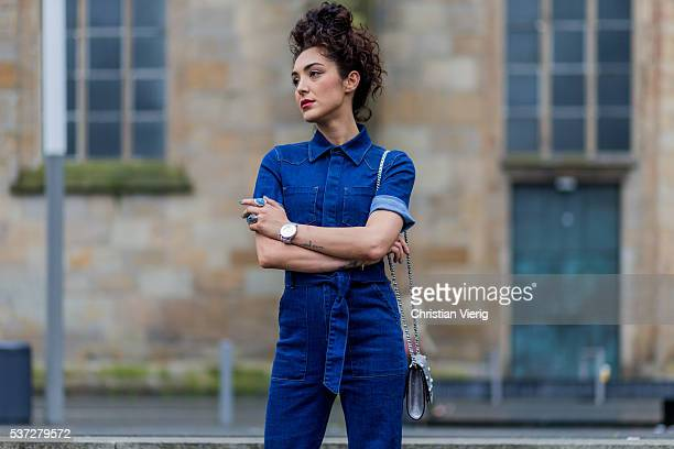Actress fashion and travel blogger SaraJoleen Kaveh Moghaddam wearing a navy blue Asos denim jeans overall a silver Delage bag on June 1 2016 in...