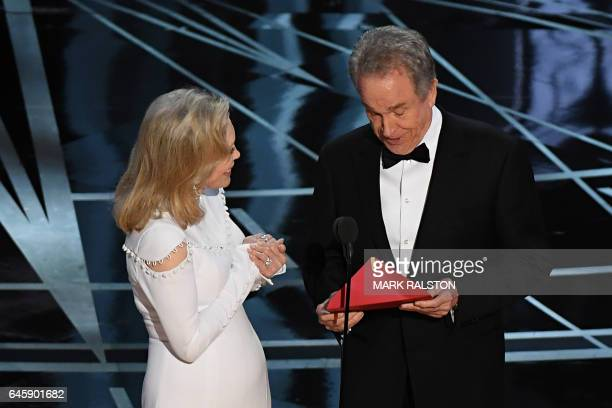Actress Faye Dunaway and actor Warren Beatty arrive on stage to announce the winner of the Best Movie category at the 89th Oscars on February 26 2017...
