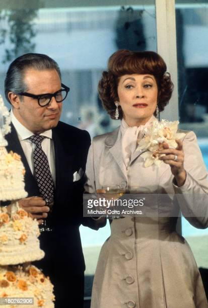 Actress Faye Dunaway and Howard Da Silva on the set of Paramount Pictures movie ' Mommie Dearest' in 1981