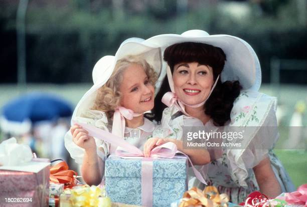 Actress Faye Dunaway and Mara Hobel on the set of Paramount Pictures movie ' Mommie Dearest' in 1981