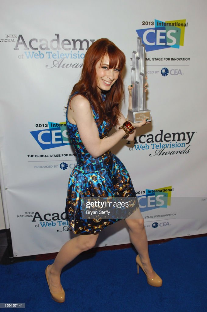 Actress Felicia Day poses with the IAWTV award for 'The Flog' Best Non Fiction Writing Award at the IAWTV Awards at the CES 2013 Show at the Palazzo...
