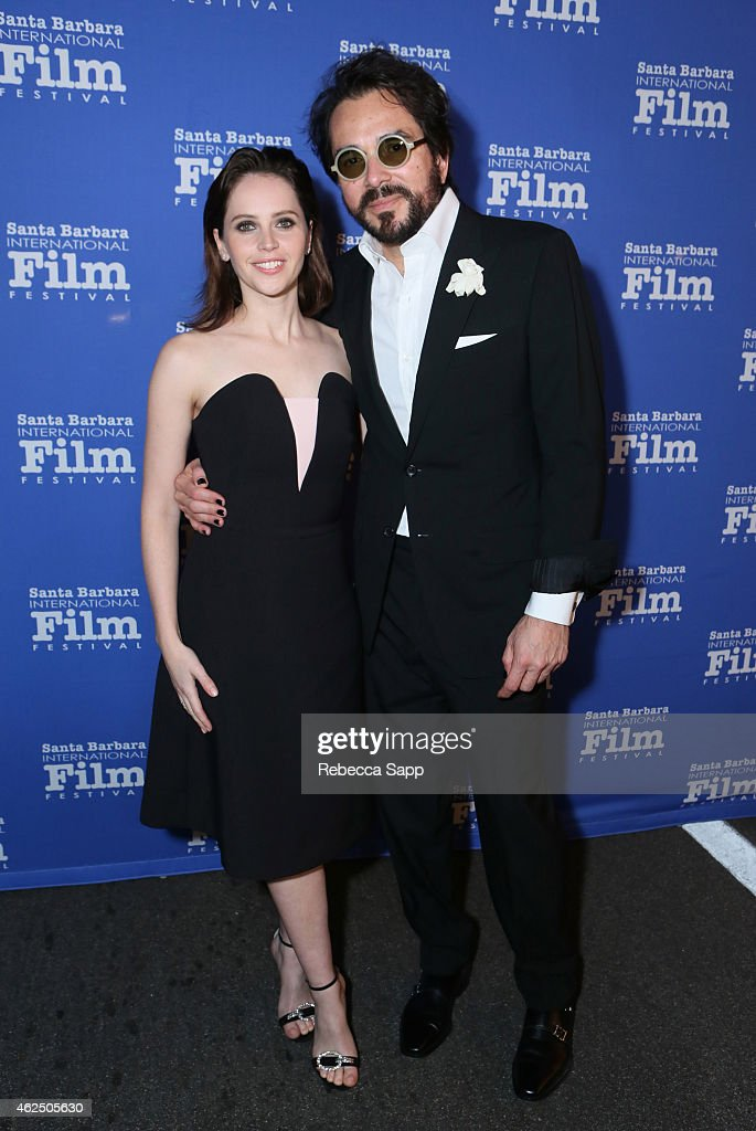 Actress Felicity Jones and SBIFF director Roger Durling attend the 30th Santa Barbara International Film Festival 'Cinema Vanguard' award for 'The...