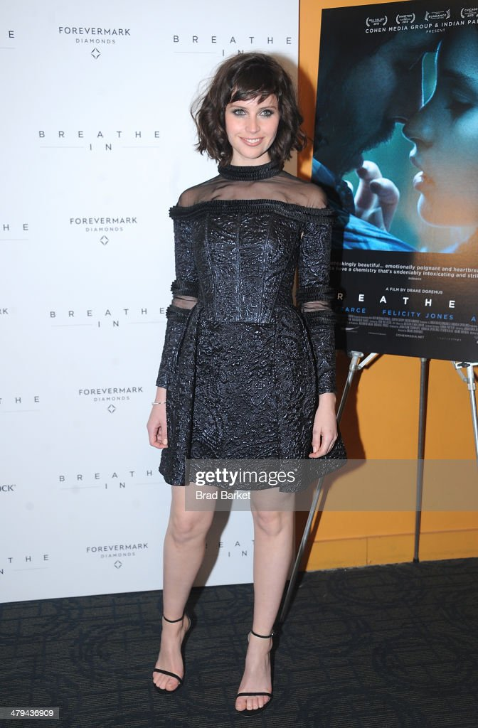 Actress <a gi-track='captionPersonalityLinkClicked' href=/galleries/search?phrase=Felicity+Jones&family=editorial&specificpeople=5128418 ng-click='$event.stopPropagation()'>Felicity Jones</a> attends the 'Breathe In' premiere at Sunshine Landmark on March 18, 2014 in New York City.