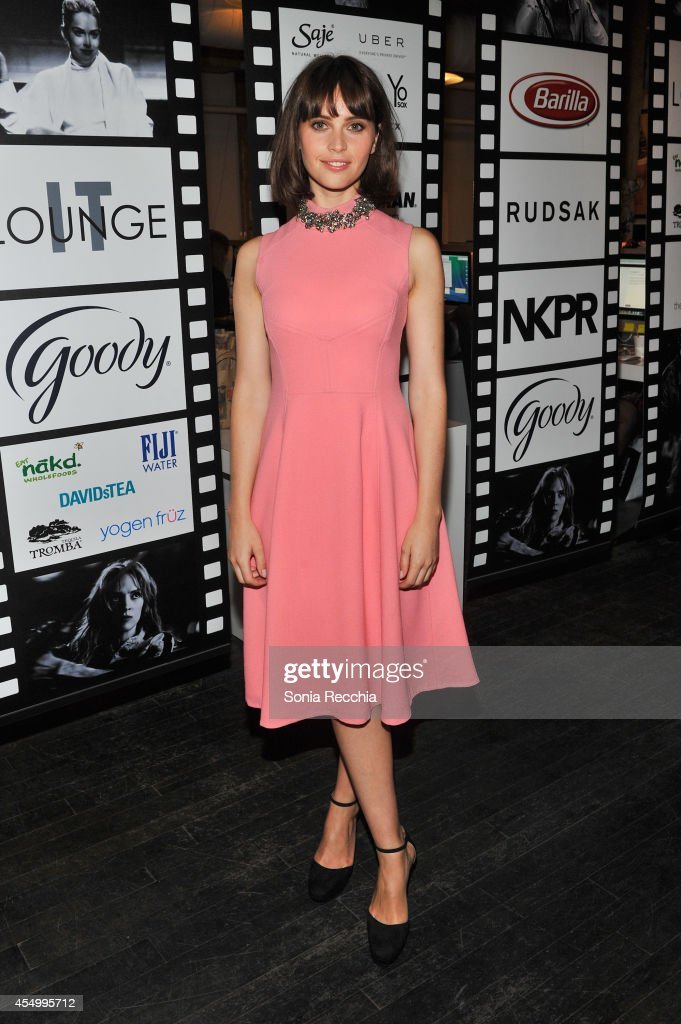 Actress Felicity Jones attends the NKPR IT Lounge Portrait Studio With W Magazine on Day 4 during the 2014 Toronto International Film Festival at the...