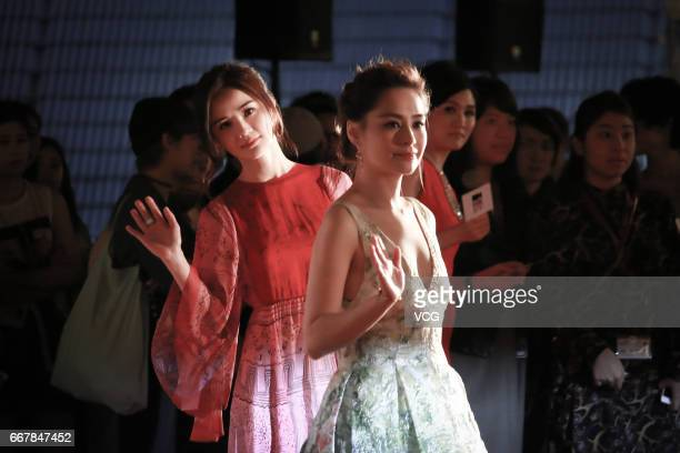 Actress film producer and singer Charlene Choi singer and actress Gillian Chung attend the premiere of director Herman Yau LaiTo's film '77...